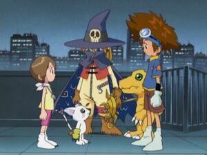 Tai, Agumon and Kari with Gatomon and Wizardmon
