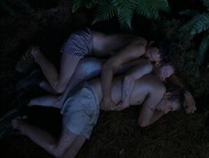 Jerry, Dan, and Tom in Without a Paddle huddling for warmth