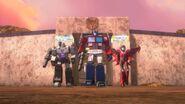 800px-Unforgotten Windblade Optimus Prime Megatron