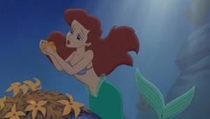 Ariel picking flower