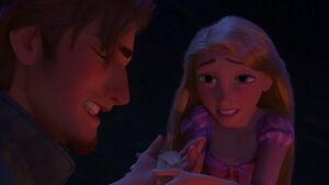Rapunzel tending to Eugene