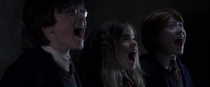 Harry Hermione and Ron screaming at Fluffy