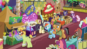 Quibble pointing at a convention booth S6E13