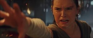 Rey pulls the lightsaber
