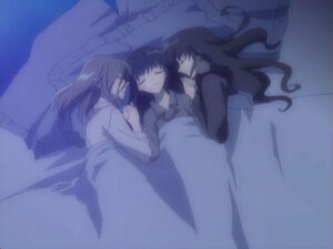 3 girls sleeping in a bed together