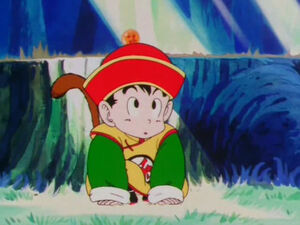 Kid Gohan looking at a blue butterfly