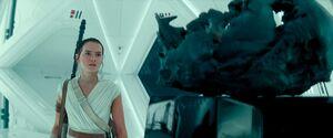 Rey inside Kylo's quarters