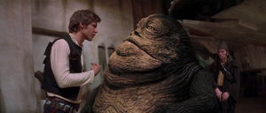 Han Solo facing Jabba The Hutt