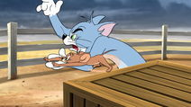 Tom and Jerry rushing to Dorothy's aid