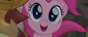 Pinkie smiling and getting an idea