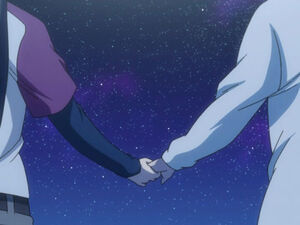 Coby & Lori holding the hands of each other