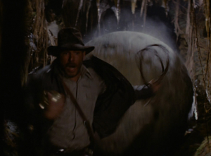 Indiana Jones running from a giant boulder
