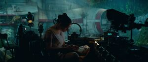 Rey studies the Jedi texts