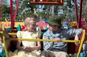 Fern and Henry boarding the Ferris Wheel