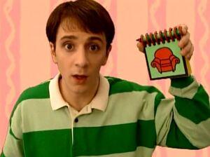 Steve holding notebook