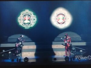 Kamen Rider Zi-O and Kamen Rider Geiz are holding Nigo Ridewatch and V3 Ridewatch