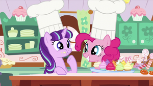 Pinkie looking at Starlight chewing cupcake S5E26