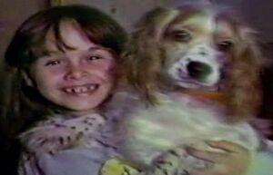 Child Annie with her dog