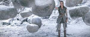 Rey lifting rocks TLJ
