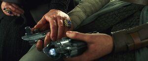 Leia holds the broken saber