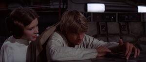 Princess Leia comforting Luke as he mourns Obi-Wans death