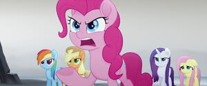 Pinkie Pie argues with Twilight while the others side with Pinkie