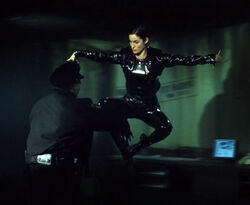 Trinity doing her karate kick.jpg