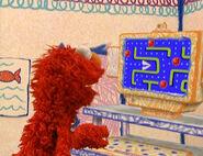 Elmo Playing Pac Man