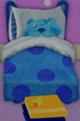 Blue was sleeping in the bed