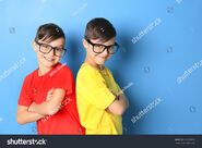 Stock-photo-twin-brothers-in-glasses-on-blue-background-579768991