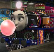 Ashima blowing bubble gum