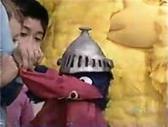 Super Grover says goodbye to his old cape
