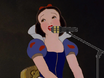 Snow white sings into the microphone