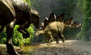Stegosaurus and Allosaurus fighting