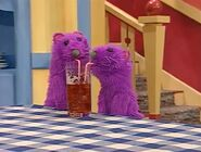 Pip and Pop drinking Bear's cup of tea