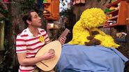 The Kindness Kid sends Big Bird to sleep with a lullaby on a lute