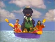 Barney and the Backyard Gang kids rowing in the swimming pool singing