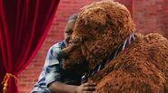 A boy and Bobo hug after saying sorry