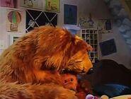 Ojo hugs Bear