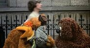 Scooter hugs Fozzie as he sings the goodbye song