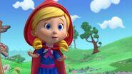 Goldie dressed as Red