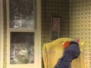 Grover goes to sleep in the chair, leaving Kermit outside in the snow