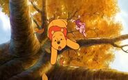 The bees knock Pooh and Piglet off the tree and they fall to the ground