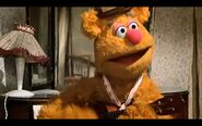 Fozzie play the ukulele in Steppin' Out With a Star