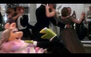 Kermit and Miss Piggy dance slowly during First Time It Happens