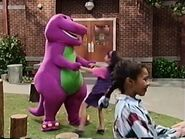 Barney and the kids spin around in circles