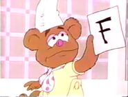 Fozzie cries because Piggy gave him a F on his report card