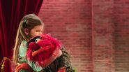 A girl group hugging Kermit and Animal