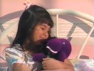 The second Barney BYG doll winks