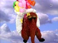 Snuffy flying with balloons in episode 4088